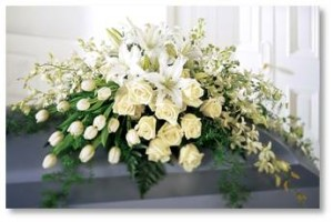 funeral flowers on casket