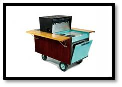 They called it the Partio cart. It had a range, oven, rotisserie and charcoal BBQ and sold for $800 in 1960.  Deluxe models included an umbrella.   Refurbished ones sell for as much as $10,000 today.  It's a party on wheels.