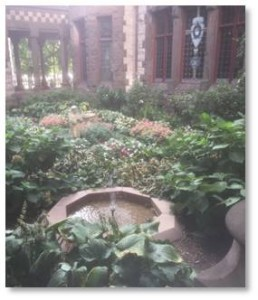 Whenever I lead a Back Bay Tour for Boston By Foot into the cloister behind Trinity Church I hear oohs and aahs of surprise as they get their first glimpse of the St. Francis garden. The garden, which is enclosed on two sides by the church building and on two sides by a cloistered walkway, grows only a few feet from the Clarendon Street sidewalk but is invisible to pedestrians. You have to climb up three stairs to catch a glimpse. Then it appears like an emerald in a rose-gold setting.