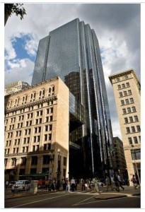 Although they could not, in the end, protect the entire building they did succeed in saving a 60-foot, L-shaped portion of the façade. The office tower, walled in blue reflective glass, rises behind it.