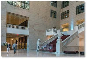 Why does a graceful marble staircase, a symbol of Gilded Age elegance, rise in the atrium of a shiny glass-walled office tower? Where did it come from? And why is it a stairway to nowhere, ending in a blank wall?