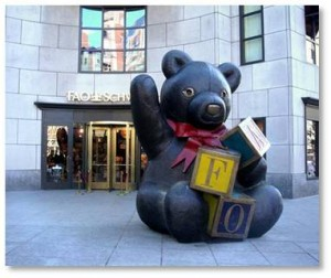 Those of us who have known Boston for a few years remember the giant bronze teddy bear that used to sit on the Boylston Street sidewalk outside the FAO Schwartz toy store. Twelve feet tall, and weighing in a three tons, the bear was kind of hard to miss. He sat happily on the pavement, waving one paw and clutching at alphabet blocks spelling FAO with the other.