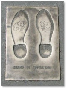 "If you are not a Democrat, you can ""stand in opposition,"" by fitting your shoes into a pair of bronze footprints on the pavement right in front of the donkey. Each one is marked with an elephant, the symbol of the Republican Party that was also popularized by Thomas Nast."