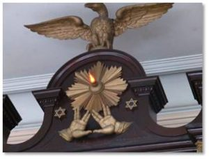An interesting note is that the Vilna Shul's Ark of the Covenant is decorated with carved lions, an eagle, a crown, and two hands raised the priestly Kohanim blessing that Star Trek fans recognize as the Vulcan greeting. The late Leonard Nimoy, who played Spock in both the Star Trek television series and the movies, grew up in the West End of Boston not far from Phillips Street. The ark also features carved clam shells, which are not kosher but definitely connect to Boston's history.