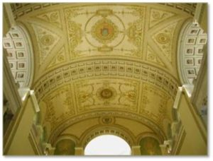 Muralist Albert Haberstroh, of the Boston firm L. Haberstroh and Son, painted the gold and white barrel-vaulted ceiling of the John Adams Courthouse. His design has bands of classical coffers with rosettes that demarcate the sections and frame the Great Seal of the Commonwealth in the center as well as the seals of the four courts that originally occupied the courthouse.
