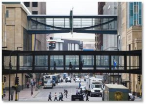"The Minneapolis ""skyways"" system is the largest in the world—so big that they have a map that lets you navigate all its numerous connections without getting lost. The skyways make it easy for people to move around the city, keep pedestrian traffic off the streets, especially during the winter months, and bring prosperous commercial nodes up to the second-floor level."