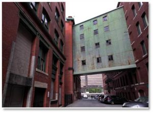 Recently residents of the Fort Point Channel district got together to protect a four-story, 19th-century overhead pedestrian bridge over Necco Court from being demolished. So clearly it had some value—and that was no skyway.