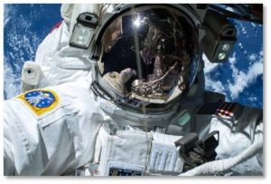 Astronaut spacewalking with earth in background