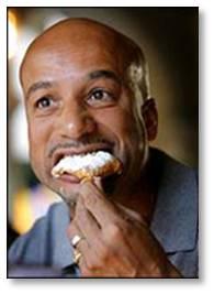 man eating a bagel