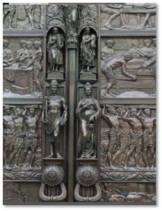 The Doors: These huge bronze doors, which weigh approximately two tons, hold ten panels in bas-relief, five on each side. They depict every step of the process of growing, harvesting, and shipping tea in Ceylon. The panels are flanked by two vertical rows of small figures in high relief. In between the panels are designs of tea leaves and tea berries.