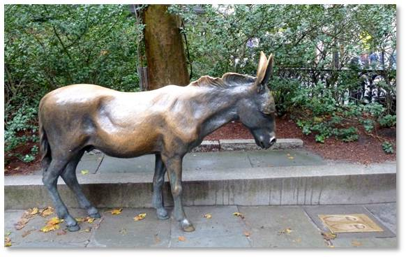 In a bit of tongue-in-cheek humor, Boston's Democratic donkey stands in the courtyard of Old City Hall on School Street. He's life size, an Italian immigrant like many Bostonians, and a bit skinny.