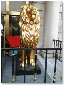 The two street level lions were gilded and moved to their current position outside what was then the Copley Plaza hotel on St. James Street. The rooftop lion disappeared and his whereabouts are still unknown.