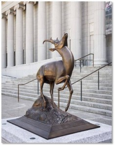 The second part is the Pronghorn Antelope, the animal that has just been struck by his arrow. The hunter, clad in loincloth and animal skin, has fired and the arrow is lodged behind the antelope's right shoulder. The antelope rears back, frozen with shock, yet still graceful.