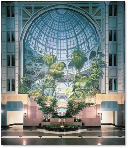 This vertical garden mural is six stories high and takes up one entire wall of the building's multi-level atrium. It draws us into a Victorian crystal garden with a multitude of tropical plants growing in front of elaborate arches and balconies, under an ornate glass dome. A fountain runs down and wild animals peer from between the branches. At the mural's base, a real fountain, bracketed by real trees, provides the garden music of tinkling water.