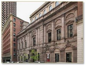 "The Boston Athenaeum's neo-Palladian façade constructed of ""Patterson sandstone"" was unique in Boston and remains so today. The original building was only three stories tall when it opened, however. A renovation designed by Henry Forbes Bigelow in 1913 and 1914 added the fourth and fifth floors, setting them back so as not to ruin the façade's symmetry. The building received a designation as a National Historic Landmark in 1966."