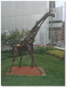 I detoured from my planned route and walked into the small garden in front and to the left of Federal Reserve Plaza's main entrance. There I got a close look at the 10-foot-tall giraffe sculpted from scrap metal by Madeleine Lord with the assistance of Robert Hesse. It was installed in 2013.