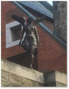 One might think the Church Court angel was a sacred object that survived the fire and was repurposed as a decoration for the condominiums. In fact, however, Mr. Gund commissioned the statue and placed her on the courtyard wall along Massachusetts Avenue. Sculpted by Gene Cauthen, the angel stands five feet, six inches high.