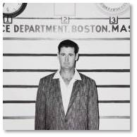 Boston Red Sox left-fielder Ted Williams stopped by to have his mug shot taken for fun.