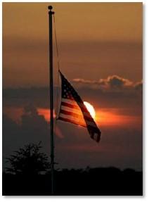 American flat, half staff, half mast, sunset
