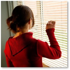 woman looking through blinds, woman looking out window, living while black