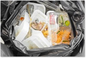 trash, plastic, clamshell containers, discarded food, food waste