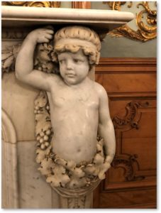 Emerson Colonial, fireplace detail, marble putti, caryatid