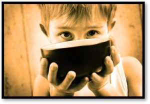 Hungry child with bowl, hunger in America