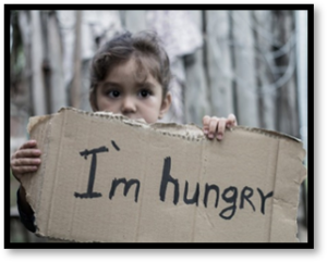 I'm hungry, hungry child with sign
