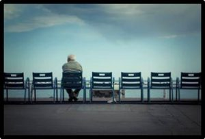 man in chair, alone, isolation, loneliness
