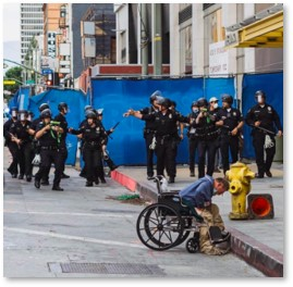 Homeless Man in Wheelchair, rubber bullets, police brutality