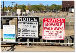 Gridley Locks, Warning signs, Movable walkways, Harbor Walk