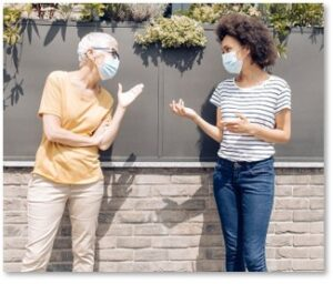 Women talking, masks, pandemic, sharing