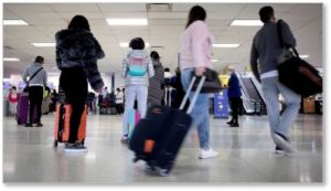 Covid-19, People in airport, travelers, Thanksgiving surge, 2020