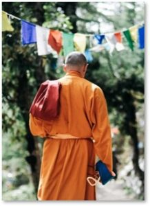 Tibetan monk, prayer flags, saffron robe, fear