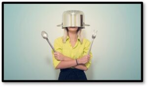 Woman with pot on head, kitchen, cooking, new recipes